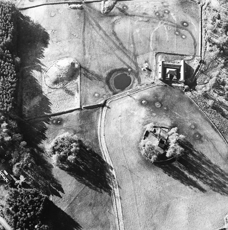 Oblique aerial view centred on the ruins of the tower-house with farmsteading adjacent, taken from the ESE.