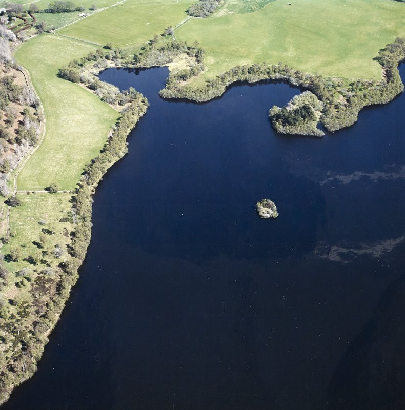 Oblique aerial view centred on the remains of the crannog, taken from the W.