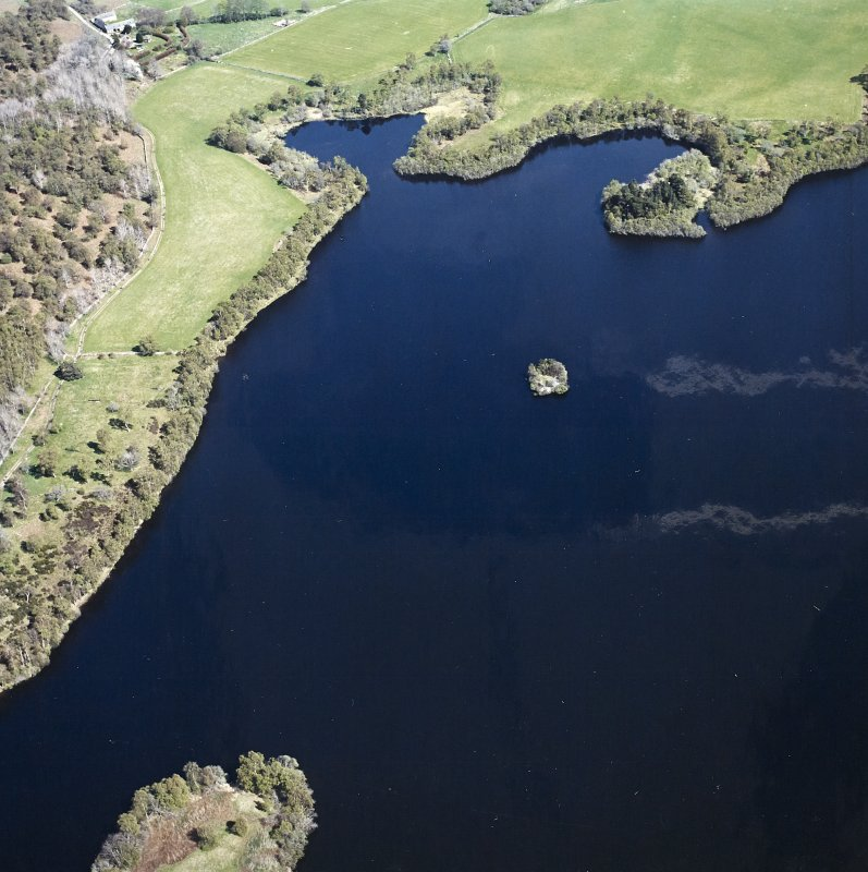 Oblique aerial view centred on the remains of the crannog, taken from the WSW.