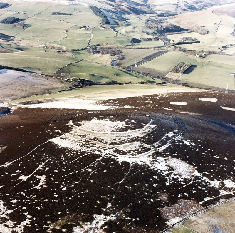 Oblique aerial view of Brown Caterthun centred on the remains of a fort, taken from the ESE.