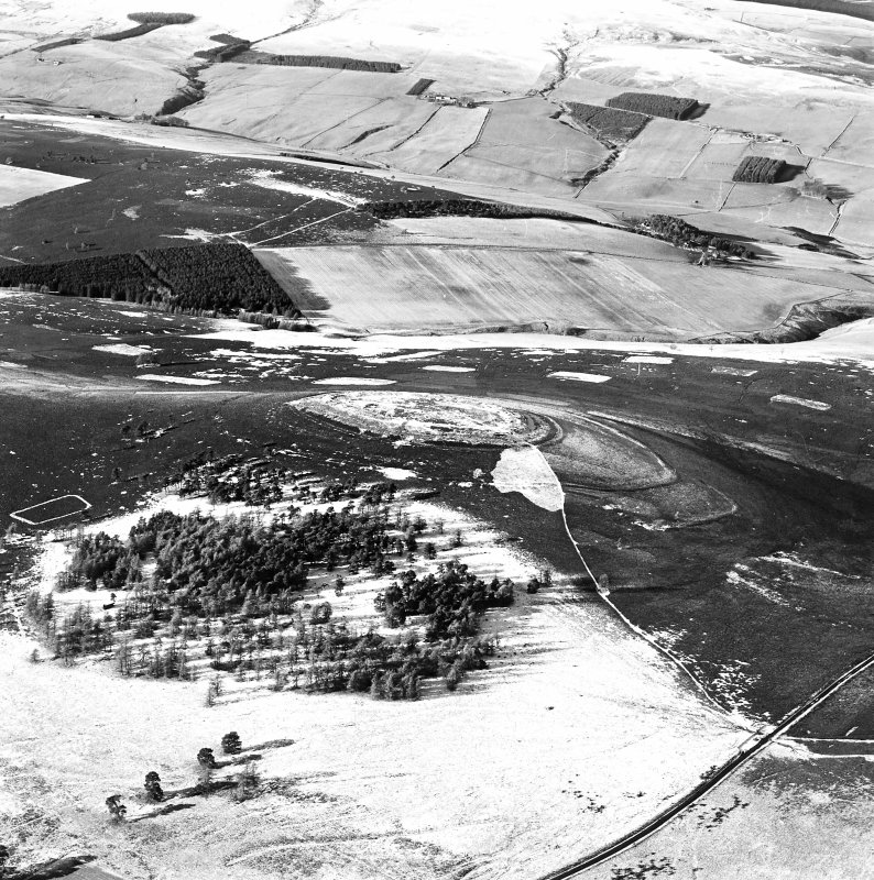 Oblique aerial view of White Caterthun centred on the remains of a fort, taken from the E.