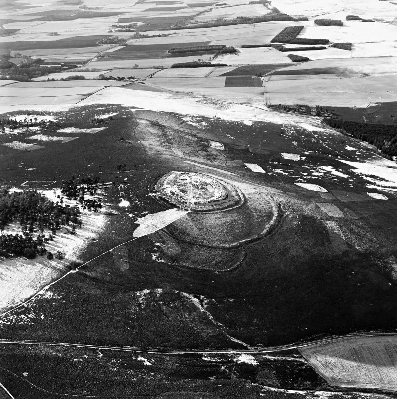 Oblique aerial view of White Caterthun centred on the remains of a fort, taken from the NE.