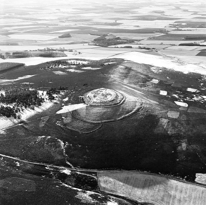 Oblique aerial view of White Caterthun centred on the remains of a fort, taken from the NNE.