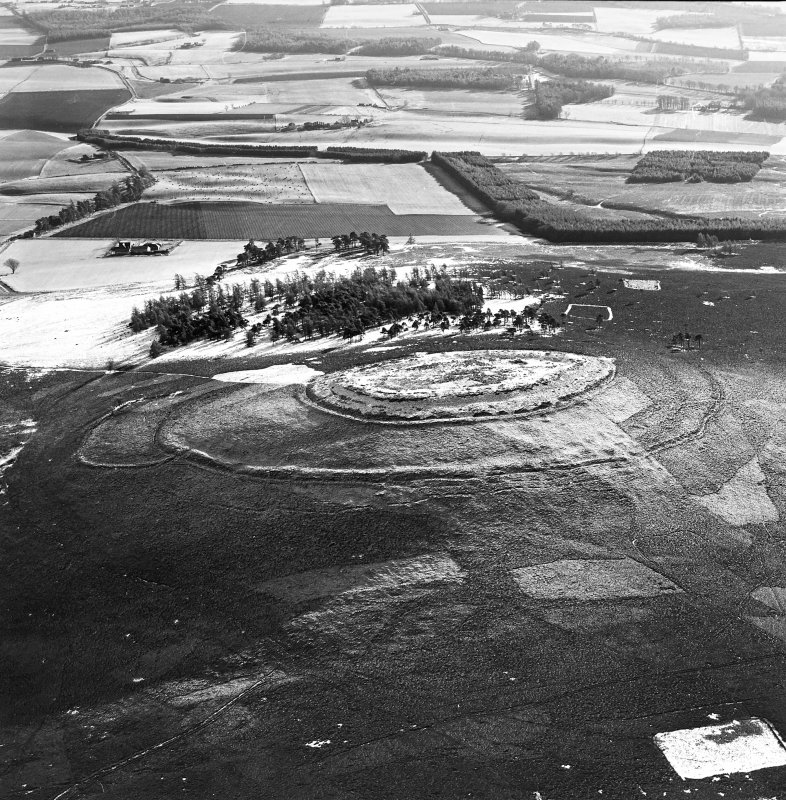 Oblique aerial view of White Caterthun centred on the remains of a fort, taken from the NW.