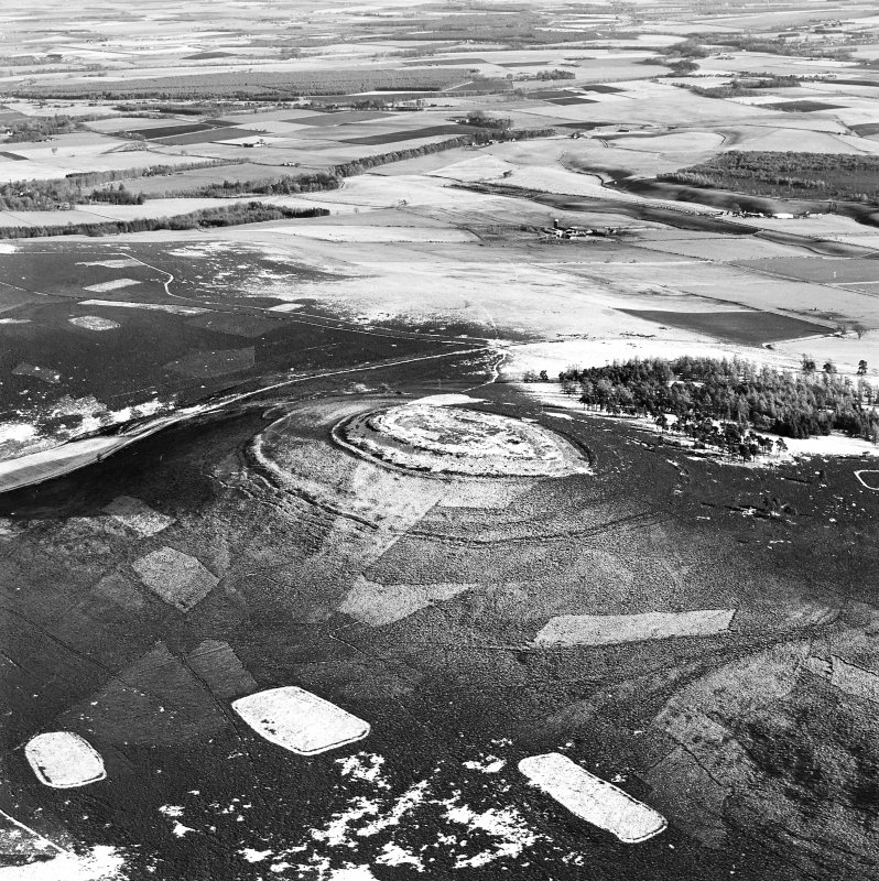 Oblique aerial view of White Caterthun centred on the remains of a fort, taken from the W.