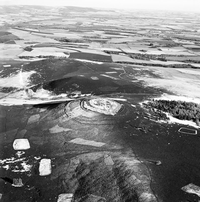 Oblique aerial view of White Caterthun centred on the remains of a fort with the remains of the Brown Caterthun fort in the background, taken from the SW.