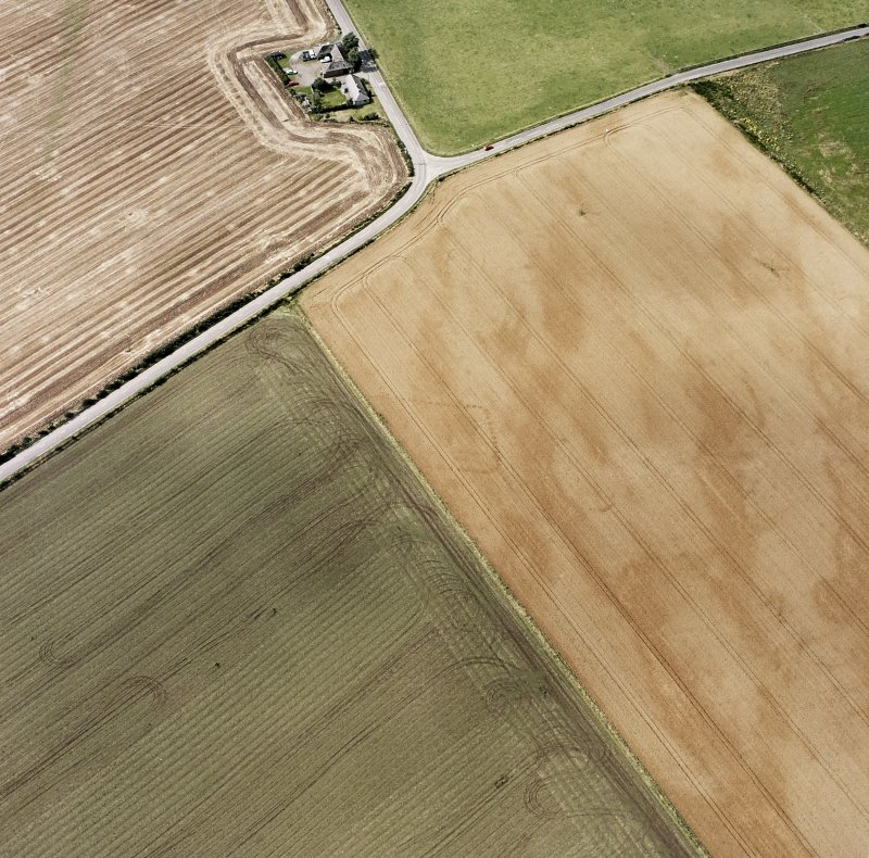 Oblique aerial views centred on the cropmarks of the NE terminal of a pit-defined cursus with ring-ditches, pits and cropmarks adjacent, taken from the ESE.
