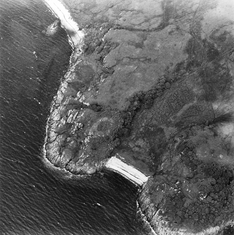 Oblique aerial view centred on the remains of the dun, taken from the SSE.