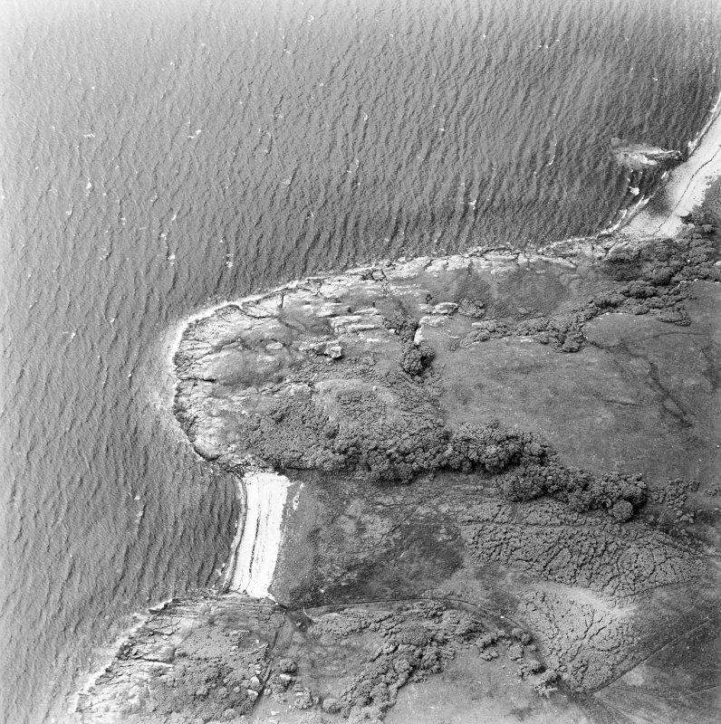 Oblique aerial view centred on the remains of the dun, taken from the ESE.