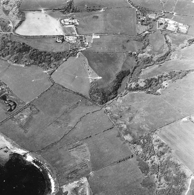 Oblique aerial view centred on the remains of the dun with the township adjacent, taken from the SSE.
