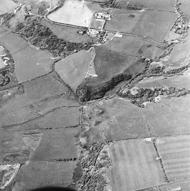 Oblique aerial view centred on the remains of the dun with the township adjacent, taken from the SE.