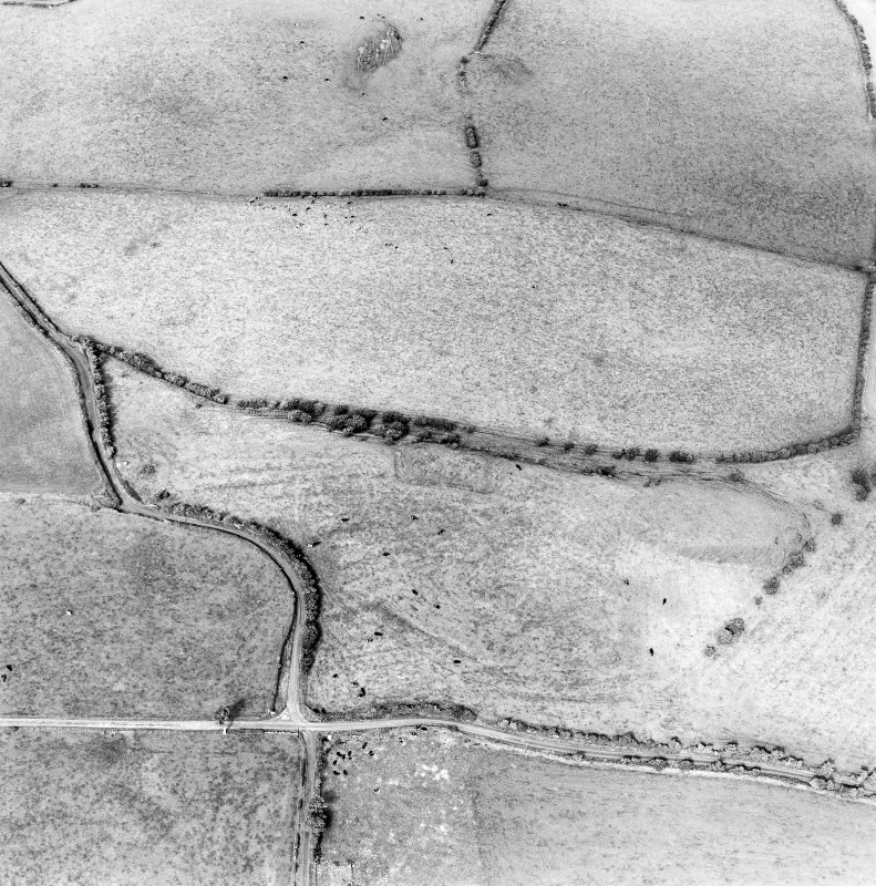 Oblique aerial view centred on the remains of the homestead moat, quarry and rig, taken from the SE.