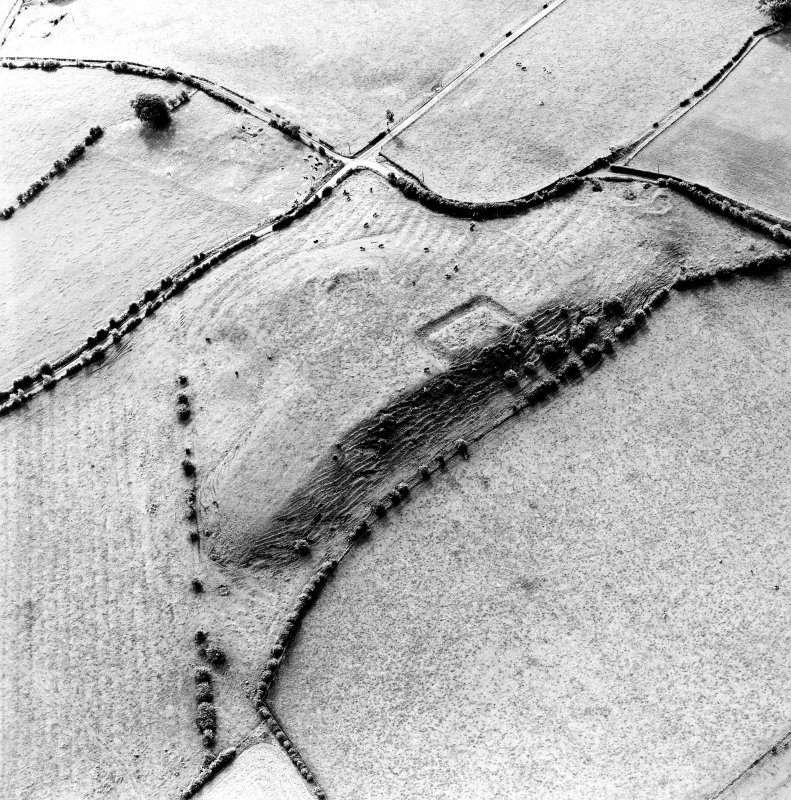 Oblique aerial view centred on the remains of the homestead moat, quarry and rig, taken from the N.