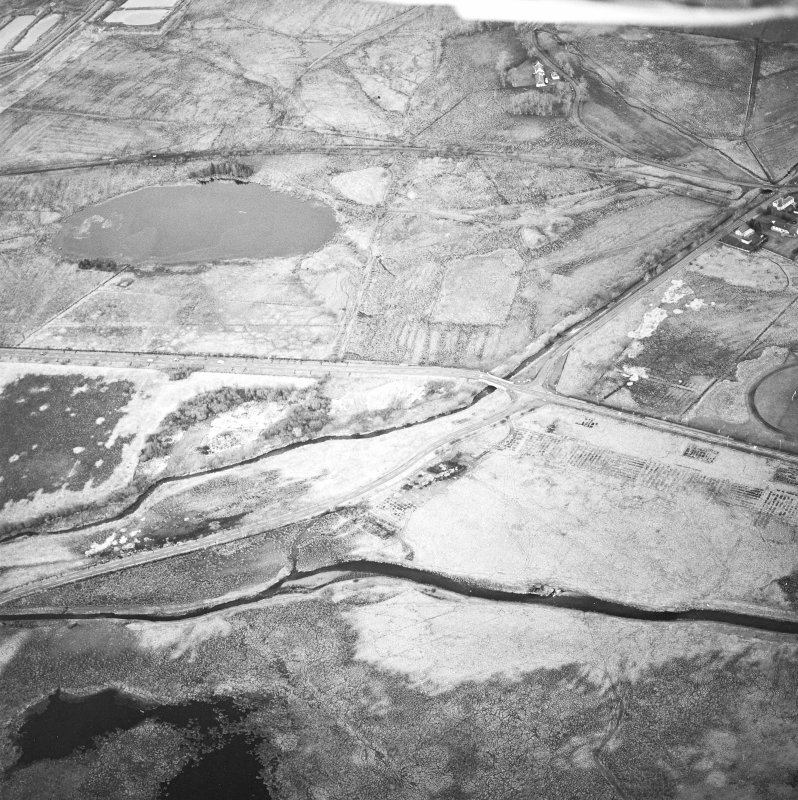 Oblique aerial view centred on the experimental plantation, taken from the SSW. Remains of concrete bases for hangers and building of First World War airfield.