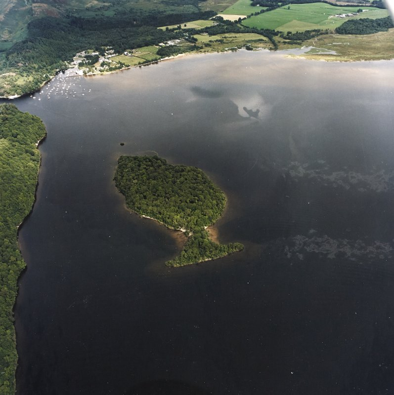 General oblique aerial view looking over Clairinsh Island and the crannog towards Balmaha, taken from the SW.
