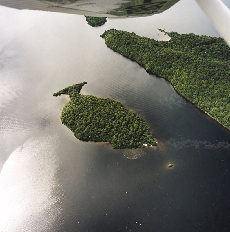 Oblique aerial view centred on Clairinsh Island with crannog adjacent, taken from the E.