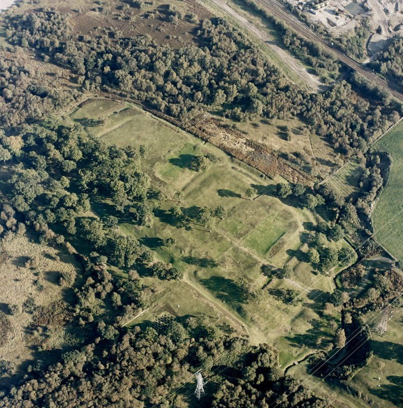 Oblique aerial view of Rough Castle centred on the remains of a Roman fort and the Antonine wall, taken from the WNW.