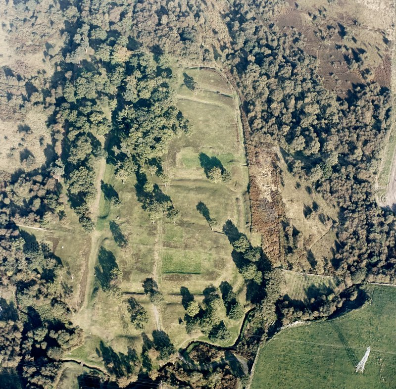 Oblique aerial view of Rough Castle centred on the remains of a Roman fort and the Antonine wall, taken from the WSW.