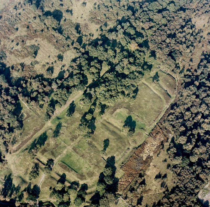 Oblique aerial view of Rough Castle centred on the remains of a Roman fort and the Antonine wall, taken from the SSW.