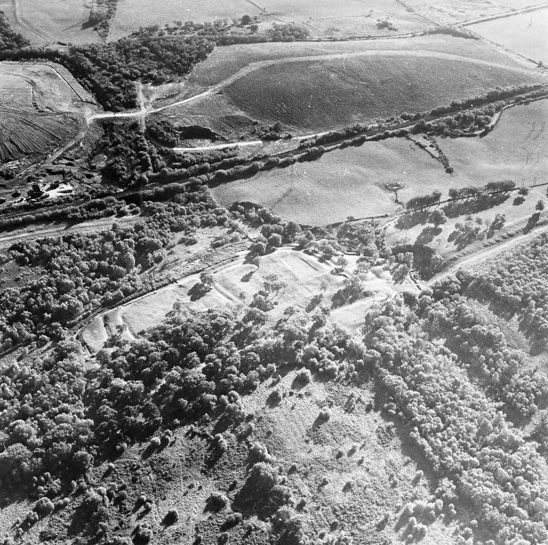 Oblique aerial view of Rough Castle centred on the remains of a Roman fort and the Antonine wall, taken from the NNE.