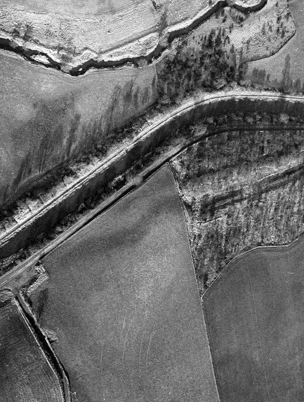 Aerial view of the Antonine Wall and site of the fortlet at Seabegs Wood from the south, centred c. NS 8113 7921.