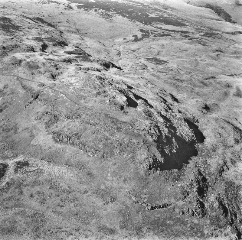 Oblique aerial photograph of summit.