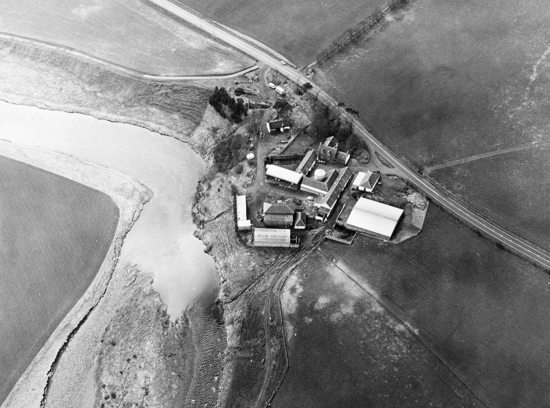 Oblique aerial view centred on the remains of the motte, taken from the ENE.