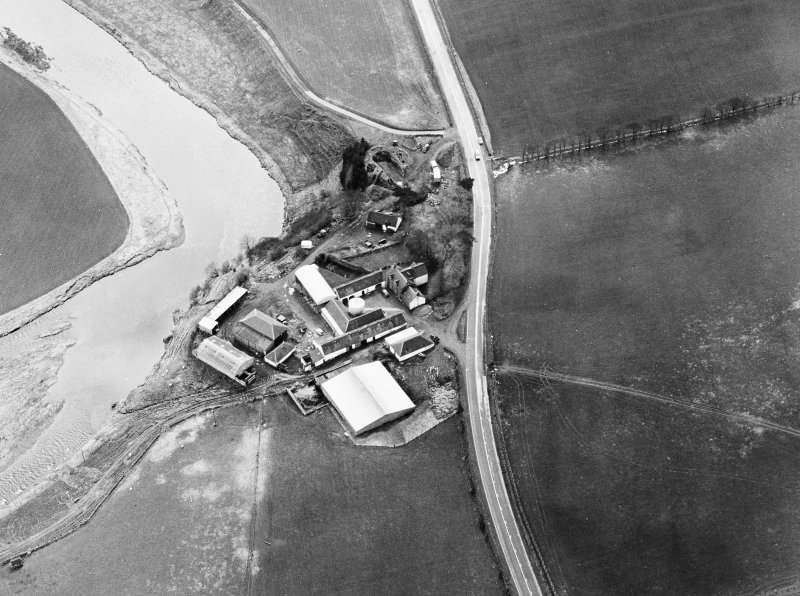Oblique aerial view centred on the remains of the motte, taken from the NE.