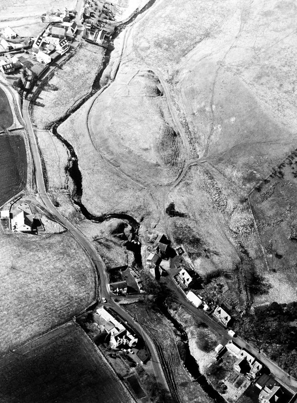 Oblique aerial view centred on the remains of the possible fort with the footbridge adjacent, taken from the ESE.
