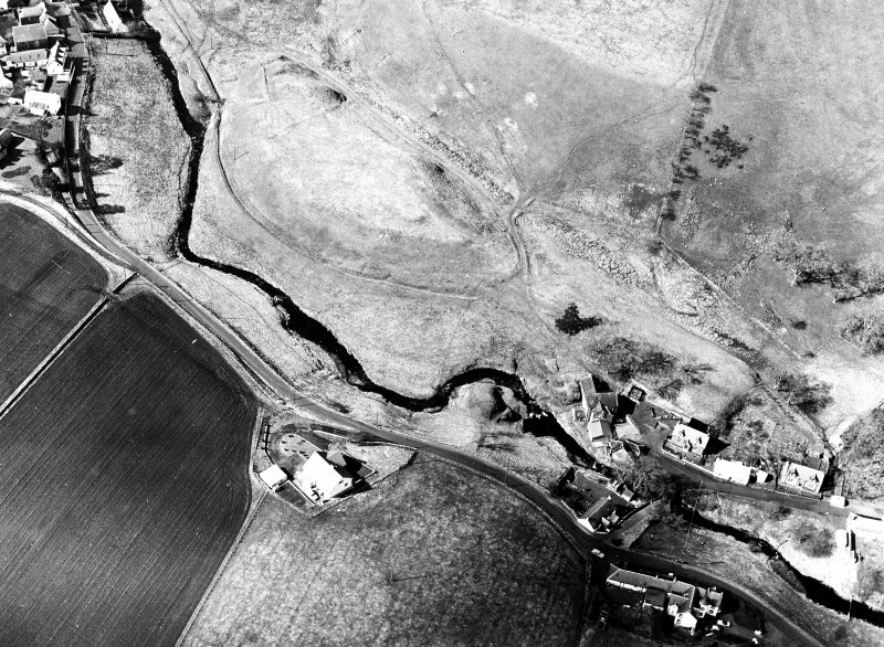 Oblique aerial view centred on the remains of the possible fort with the footbridge adjacent, taken from the SE.