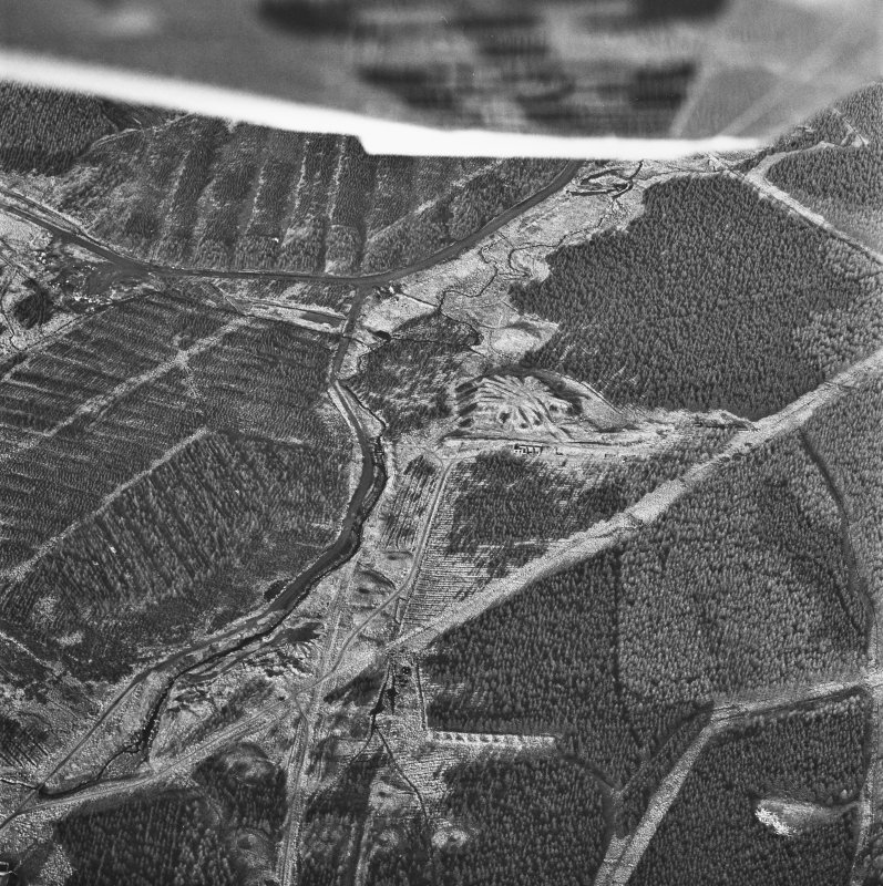 Wilsontown, oblique aerial view, taken from the NE, showing the bings of two coal mines in the centre of the photograph, and the remains a worker's row, and bell pits, at the bottom.