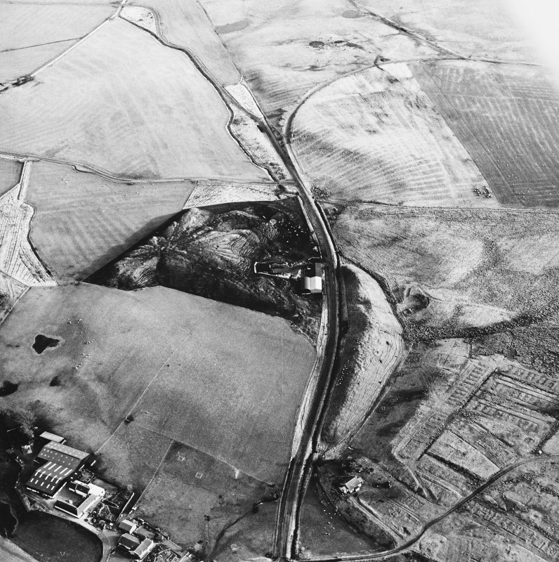Haywood and Droveloan, oblique aerial view, taken from the W, showing Haywood village with the remains of miners' rows, and a war memorial, in the bottom right-hand corner of the photograph, a cottage and the two bings of a coal mine adjacent to the dismantled railway in the centre, and an area of rig at Droveloan cottage in the top half.
