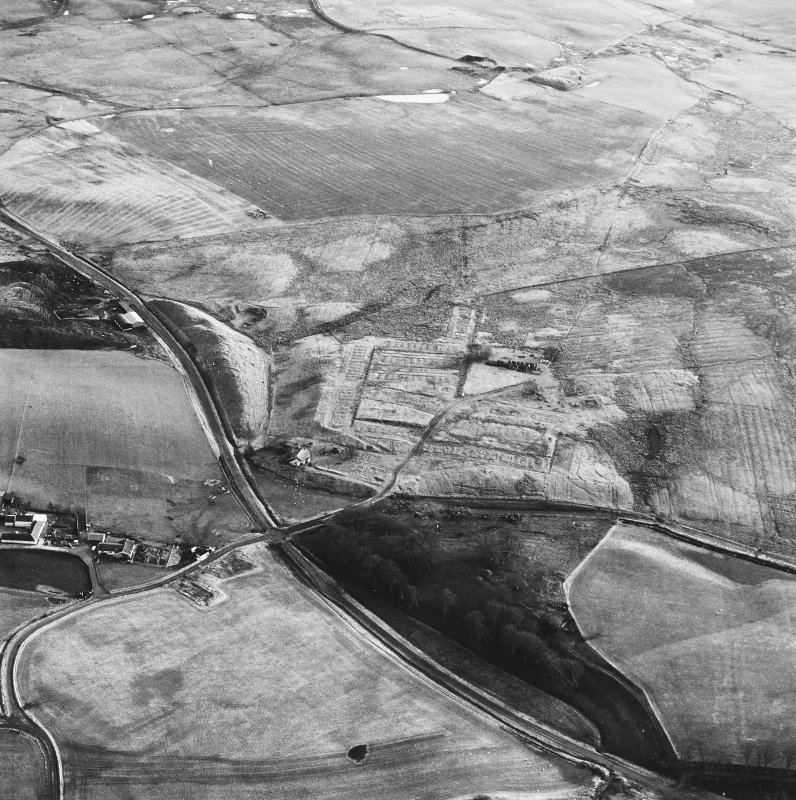 Haywood, Droveloan and Greenbank, oblique aerial view, taken from the NNW, showing Haywood village with the remains of miners' rows and a farmstead in the centre of the photograph, two bings of a coal mine adjacent to the dismantled railway in the left centre, and areas of rig at Droveloan cottage in the top half, and Greenbank in the right.