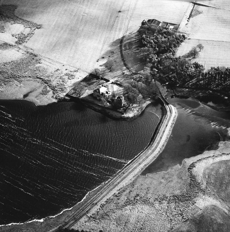 Cairns Castle Tower and Broom Hill, oblique aerial view, taken from the NW, showing the tower in the centre of the photograph beside the house, and an area of rig and furrow cultivation in adjacent fields.