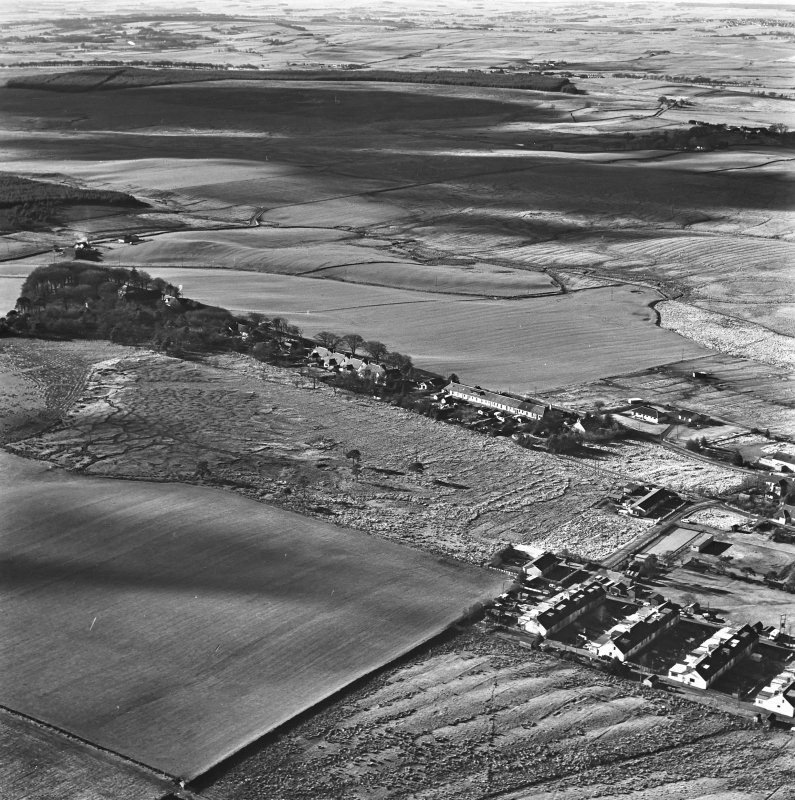 Tarbrax Shale-Oil Works, oblique aerial view, taken from the E, showing Tarbrax village in the centre. Three areas of rig are visible, one beside the village in the bottom of the photograph, and further areas at Greenfield Burn, and Lawhead, in the centre, and centre left respectively.