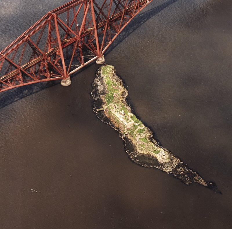 Oblique aerial view of The Forth Bridge and Inch Garvie centred on the rail bridge and the remains of a castle, battery, coast battery and artillery fortifications, taken from the ESE.