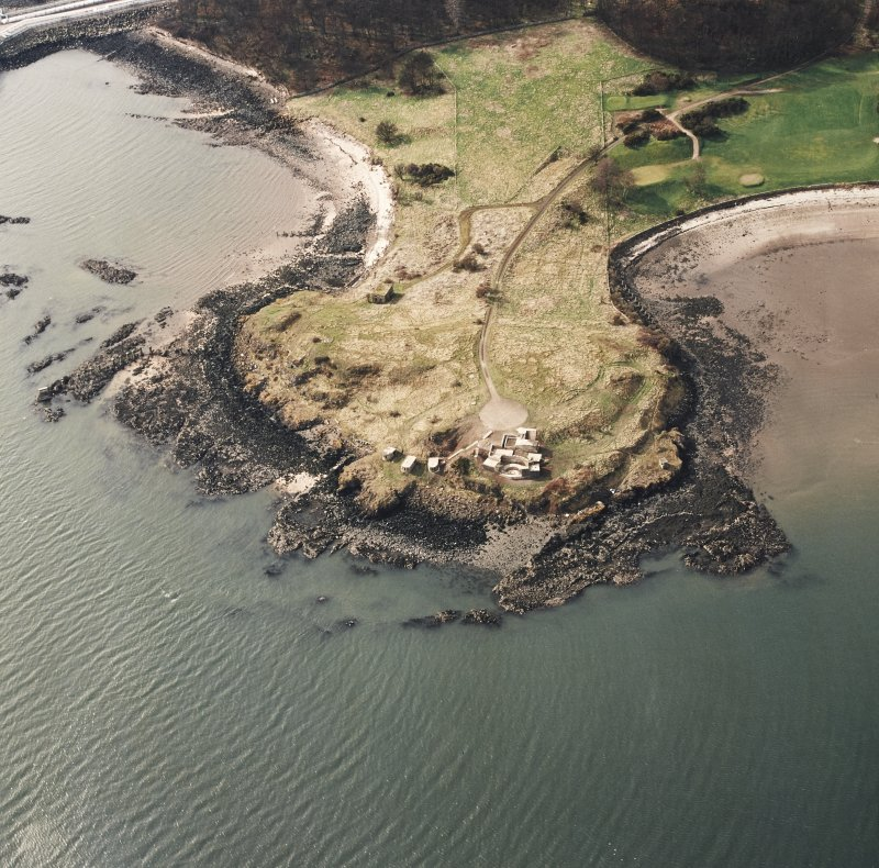 Oblique aerial view of Charles Hill centred on the remains of a coast battery and military camp with a ferry-house cellar adjacent, taken from the E.