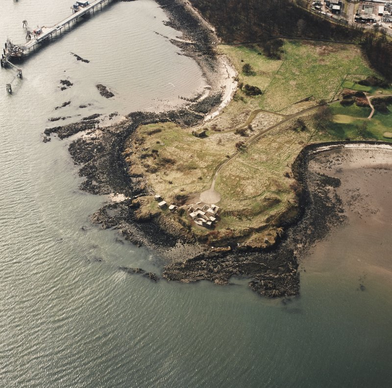 Oblique aerial view of Charles Hill centred on the remains of a coast battery and military camp with a ferry-house cellar adjacent, taken from the NE.
