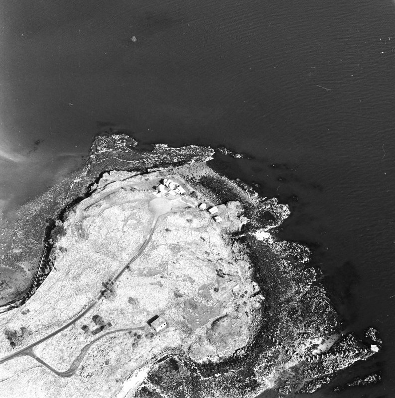Oblique aerial view of Charles Hill centred on a coast battery with a ferry-house cellar adjacent, taken from the SW.