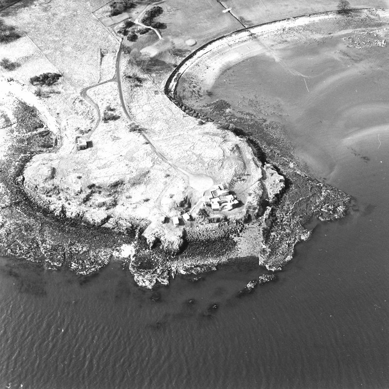 Oblique aerial view of Charles Hill centred on a coast battery with a ferry-house cellar adjacent, taken from the SE.