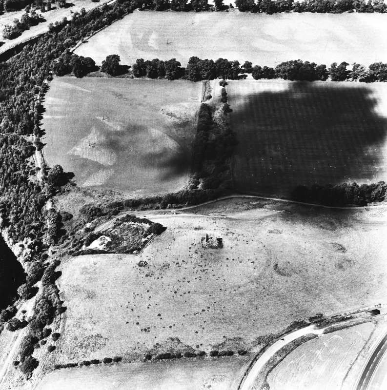 Horsburgh Castle, oblique aerial view, taken from the E, centred on the Tower surrounded by the cropmarks of a fort. The SW corners of Eshiels Roman Temporary Camps are visible in the top right-hand corner of the photograph.