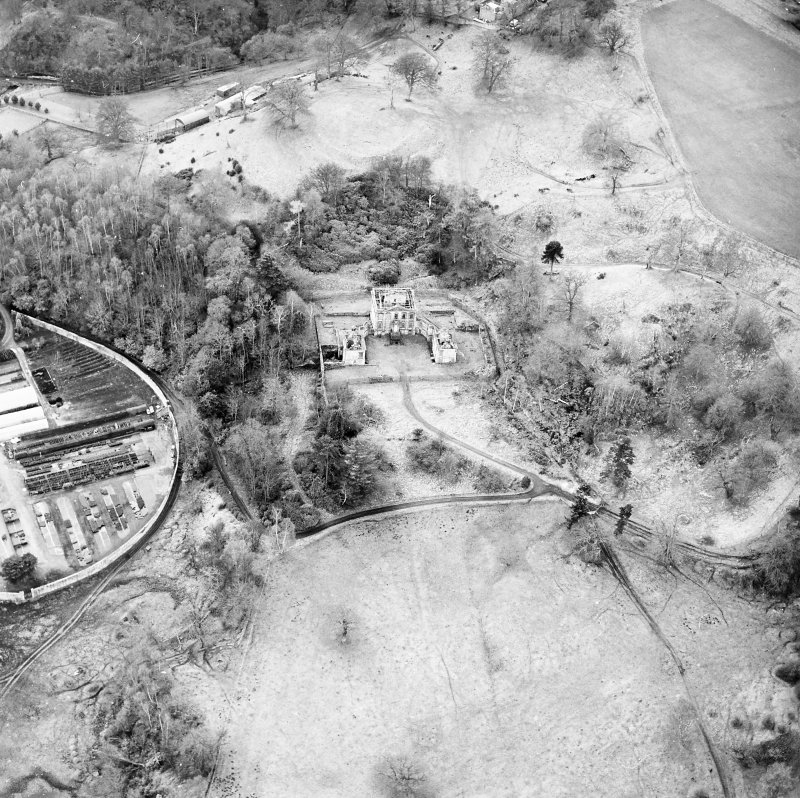 Oblique aerial view of Mavisbank House centred on the country house, earthwork, and cropmarks of a pond taken from the NE.