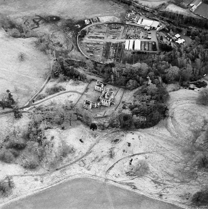 Oblique aerial view of Mavisbank House centred on the country house, earthwork, and cropmarks of a pond, taken from the WNW.