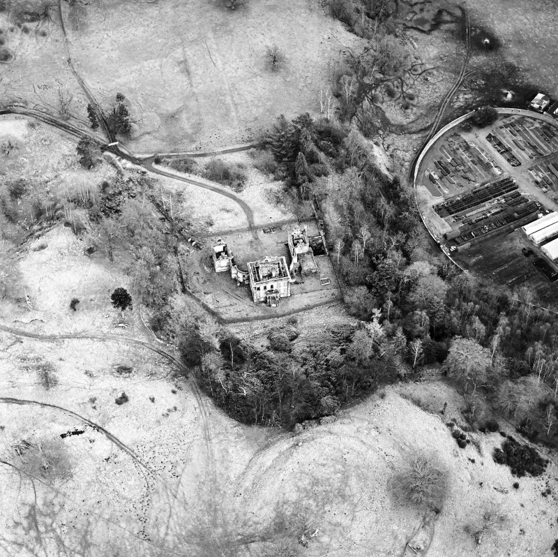 Oblique aerial view of Mavisbank House centred on the country house, earthwork, and cropmarks of a pond, taken from the WSW.
