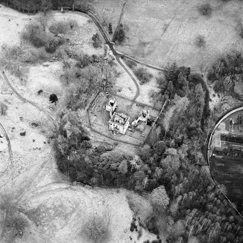 Oblique aerial view of Mavisbank House centred on the country house, earthwork, and cropmarks of a pond, taken from the NNW.