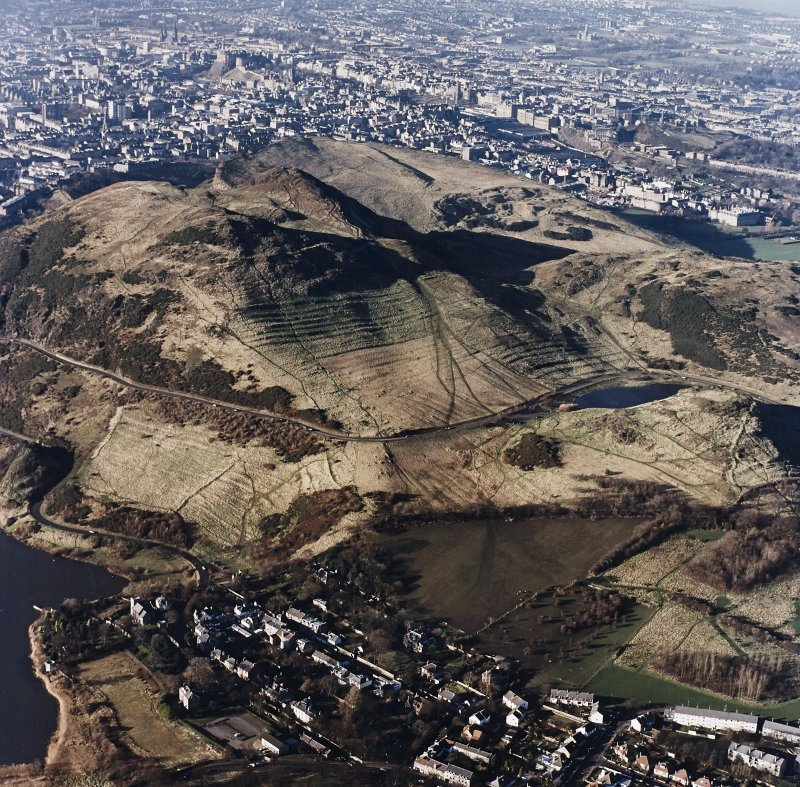 Oblique aerial view of Holyrood Park centred on the remains of cultivation terraces on the slopes of Arthur's Seat with Dunsapie Hill adjacent, taken from the ESE.