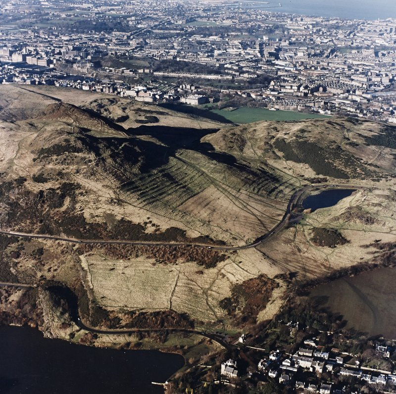 Oblique aerial view of Holyrood Park centred on the remains of cultivation terraces and rig, taken from the SE.