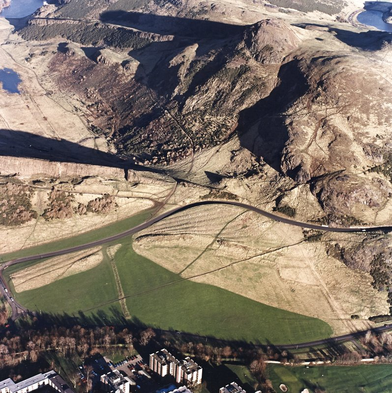 Oblique aerial view of Holyrood Park centred on the remains of cultivation with Arthur's Seat behind, taken from the SW.