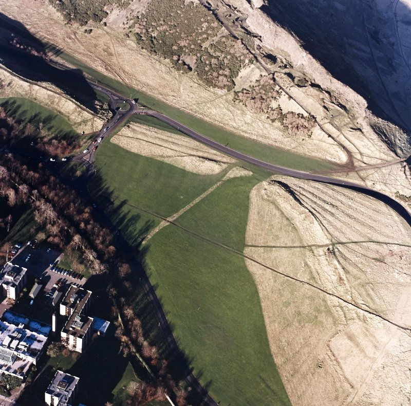 Oblique aerial view of Holyrood Park centred on the remains of cultivation, taken from the SE.