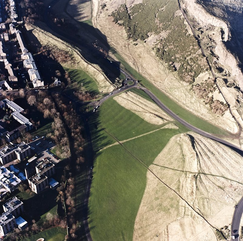 Oblique aerial view of Holyrood Park centred on the remains of cultivation, taken from the SSE.